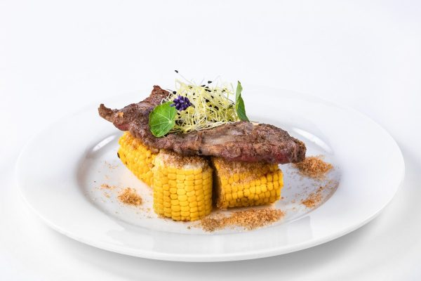 Rib Eye Steak with grilled chili corn and parmesan